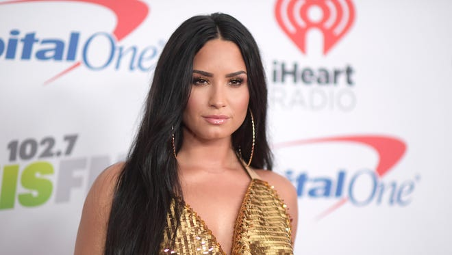"""Six years ago, I was drinking vodka out of a Sprite bottle at 9 in the morning, throwing up in the car,"" Lovato told a Brooklyn audience Friday. ""So, I took a look at my life and I said, 'Something has to change, I've got to get sober.' So, I did."""