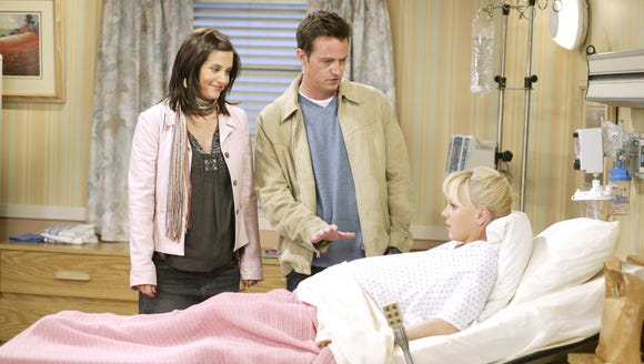 Courtney Cox as Monica, Matthew Perry as Chandler and