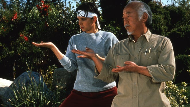 "Daniel (left, Ralph Macchio) gets a lesson from Mr. Miyagi (Pat Morita) in 1984's ""The Karate Kid.'"