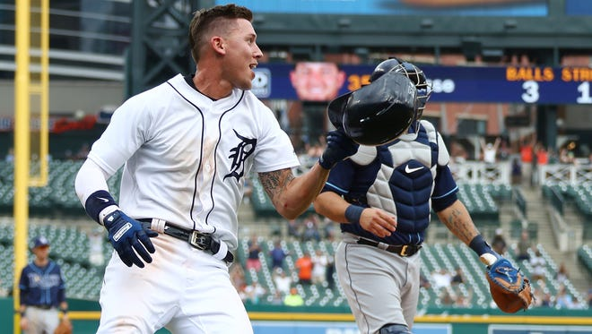 JaCoby Jones of the Detroit Tigers celebrates after scoring the game winning run in the 12th inning.