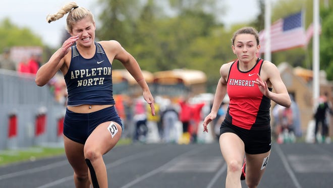 Appleton North High School's Gabby Smith and Kimberly High School's Molly Greeninger compete in the 100m dash during the WIAA Division 1 track and field regional on Monday, May 21, 2018 in Kimberly, Wis. 