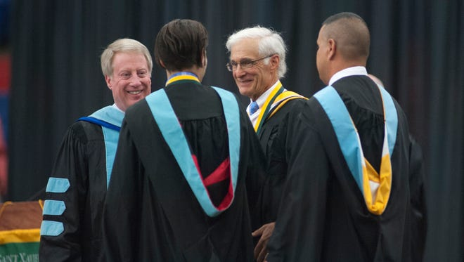 Perry Sangalli, far left, seen in this May 25, 2018, photo at St. Xavier High School's graduation. Teacher Ed Noe, second from left, was the recipient of excellence in teaching award. At Noe's right is Thomas Borders, outstanding alumnus recipient. At far right is St. X Principal Francisco Espinosa.