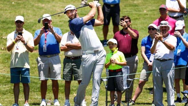 Golfer Dustin Johnson tees off during the InnerWorkings Pro-Am on Wednesday at the FedEx St. Jude Classic at TPC Southwind.