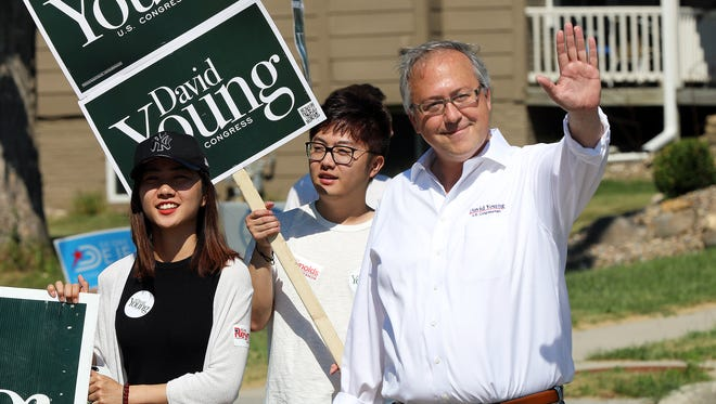 Congressman David Young waves to the crowd during the Four Seasons Festival parade as it travels along West Broadway St. in Polk City on Saturday, July 21, 2018.
