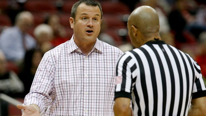 U of L head coach Jeff Walz chatted with referee against Belmont during their game at the KFC Yum! Center.Nov. 20, 2014