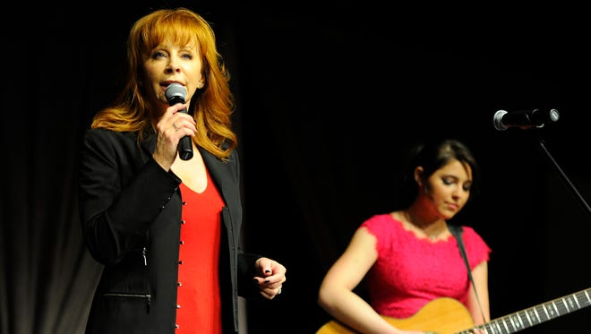 Reba McEntire and Caroline Kole perform at the Hearts of Hope Luncheon raising funds and awareness for homeless women and children Saturday.