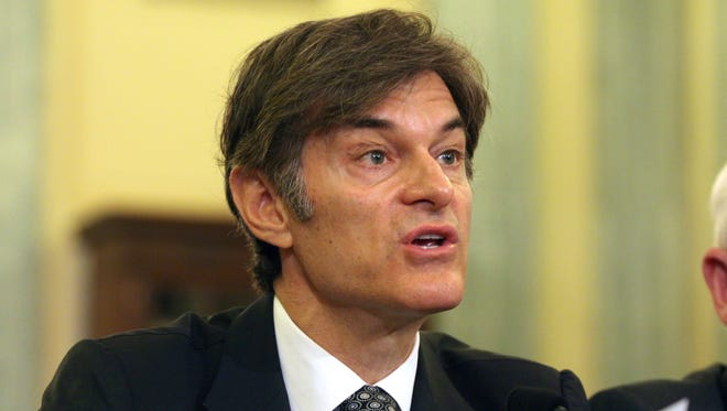 Dr. Mehmet Oz, vice chairman and professor of surgery, Columbia University College of Physicians and Surgeons, testifies on Capitol Hill in Washington on June 17, 2014.
