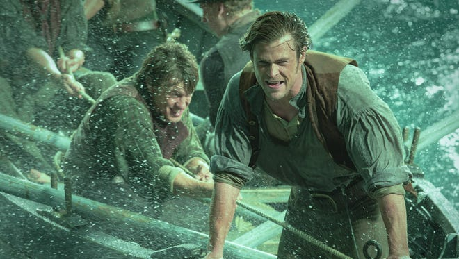 """This photo provided by Warner Bros. Pictures shows, Chris Hemsworth, right, as Owen Chase, and Sam Keeley as Ramsdell, left, in a scene from the film, """"In the Heart of the Sea."""" The movie opens in U.S. theaters on Dec. 11, 2015."""