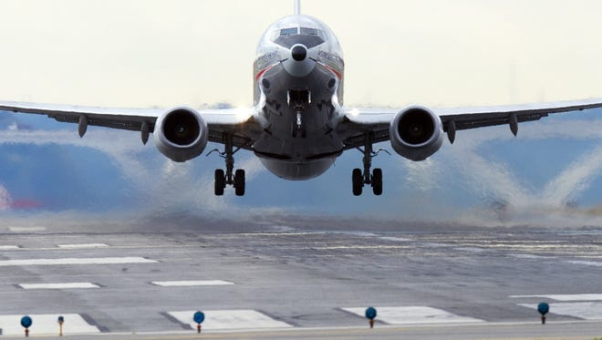 An American Airlines Boeing 737 takes off from Washington Reagan National Airport.
