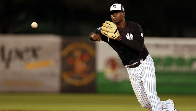 New York Yankees shortstop Didi Gregorius throws the ball to first base for an out during the sixth inning against the Toronto Blue Jays at George M. Steinbrenner Field in Tampa Wednesday. Comcast has dropped the YES Network, which carries most Yankees games, from its lineup.