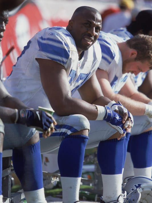 Tracy Scroggins #97 of the Detroit Lions sits on the bench.
