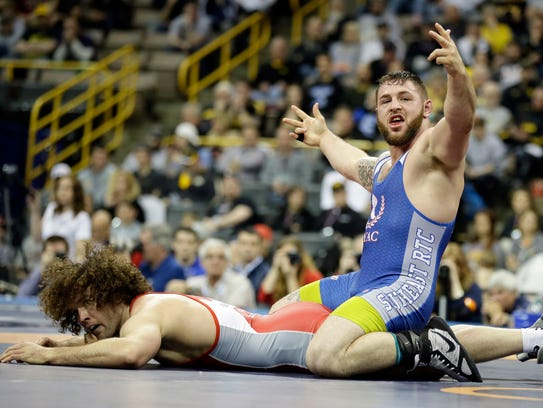 Ben Provisor, top, reacts as he defeats Jordan Holm