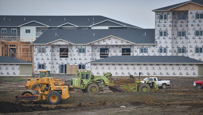 Construction takes place in front of Graystone Apartments, Thursday, Oct. 5, in Sioux Falls. This lot in front of Graystone Apartments will be for shopping centers and parking lots near the apartment complex.