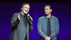 Quentin Tarantino (L) and Leonardo DiCaprio speak about