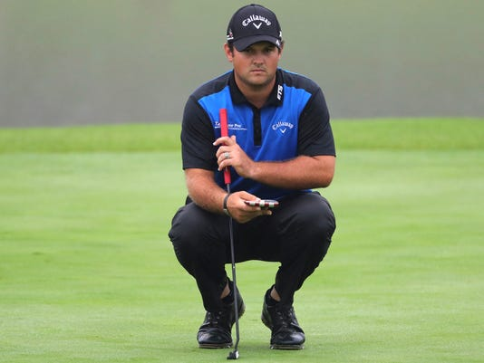 Patrick Reed of the U.S. lines up his putt during the WGC-HSBC Champions golf tournament at the Sheshan International Golf Club in Shanghai, China, Thursday, Oct. 27, 2016. (AP Photo/Ng Han Guan)