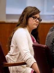 Anissa Weier listens as Melissa Westendorf, a forensic