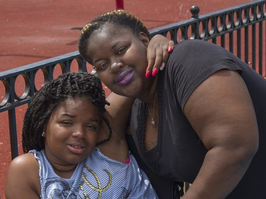 Shandar Parke hugs her daughter Yesenia, who was shot and paralyzed by her father.
