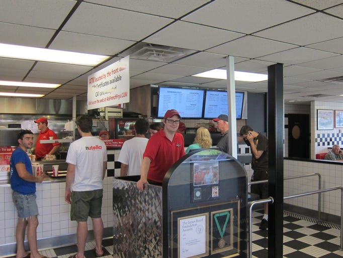 At Al's you order and pay at one of these kiosks, then proceed to the counter to oversee your food being prepared.
