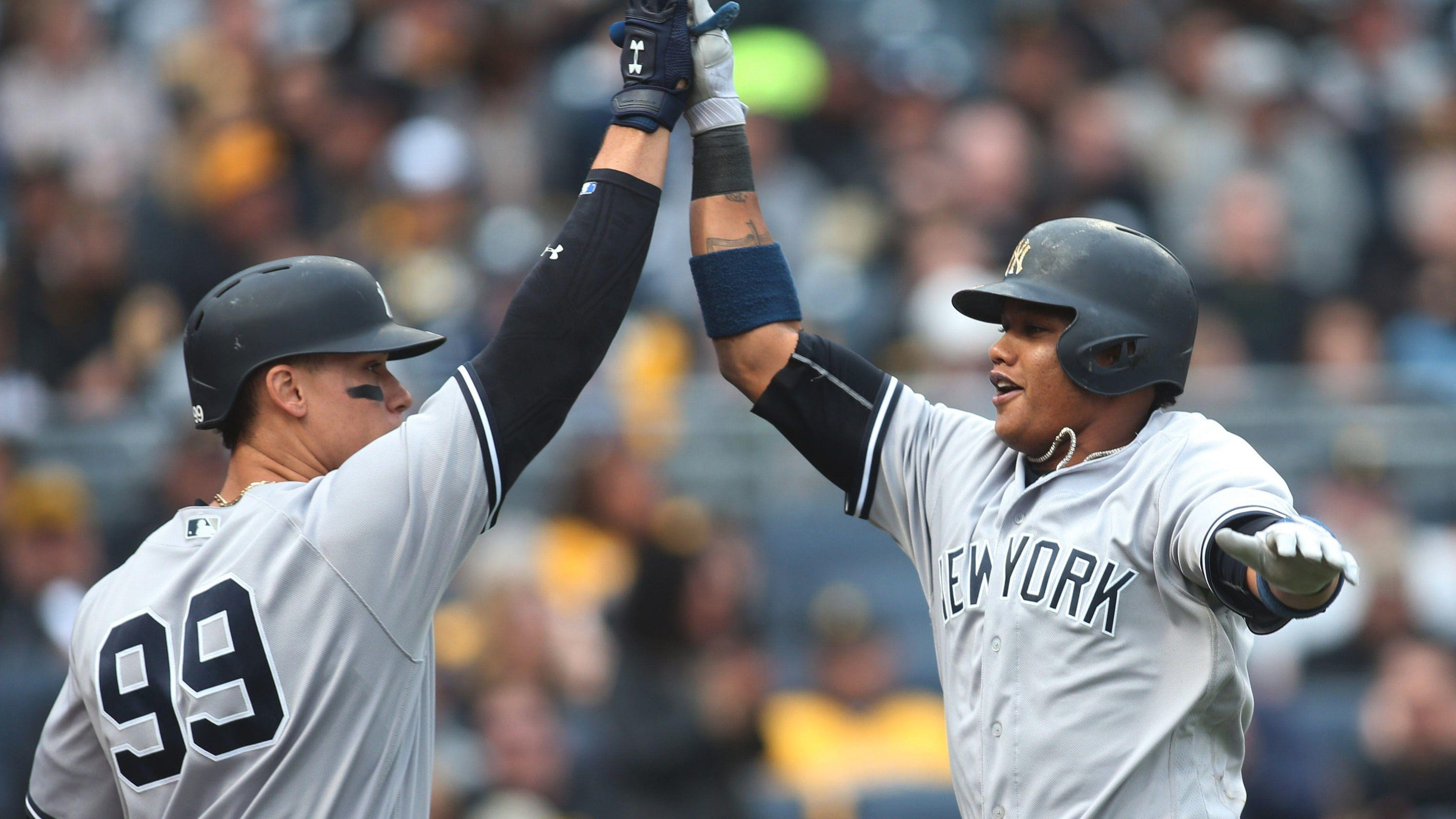 Carter's blast off the bench lifts Yankees past Pirates