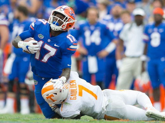 Florida defensive lineman Jordan Sherit (17) gets downed
