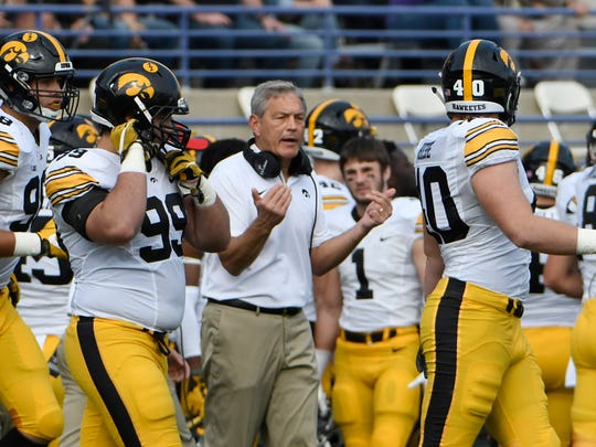 Oct 21, 2017; Evanston, IL, USA; Iowa Hawkeyes head coach Kirk Ferentz talks with his team during the first quarter against Northwestern at Ryan Field. Mandatory Credit: David Banks-USA TODAY Sports