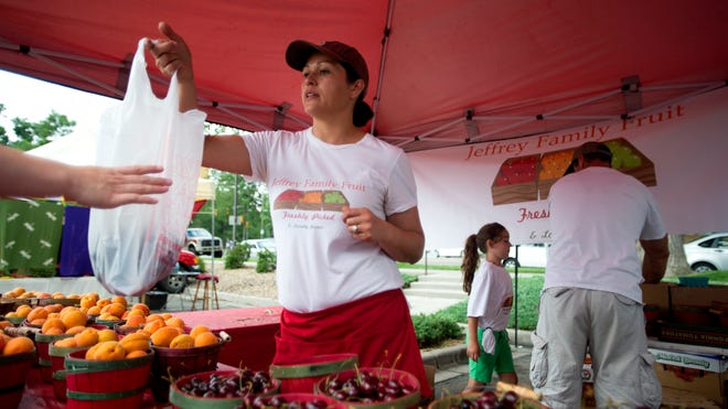 Amparo Jeffrey sells cherries at the Larimer County Farmers Market Saturday, July 12, 2014. The market is held every Saturday in the Larimer County Courthouse parking lot on the corner of Oak and Mason Streets from 8 a.m. to noon.