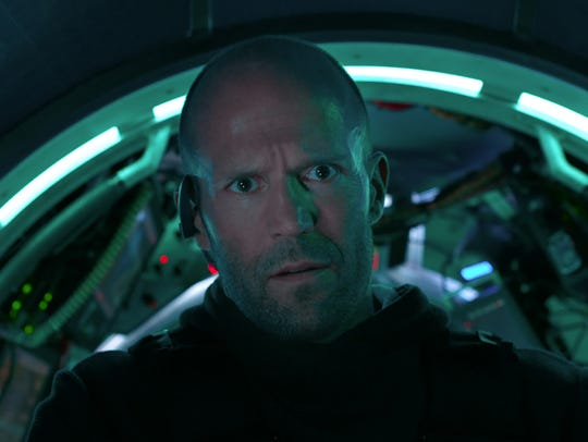 Jason Statham faces off against a giant shark foe in