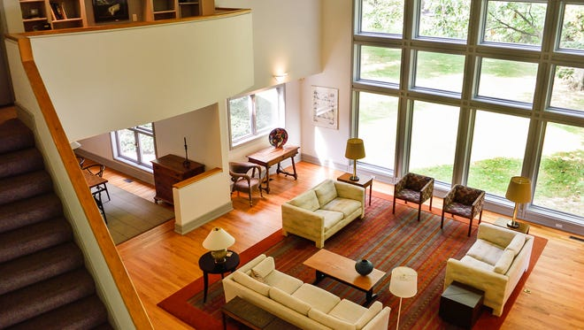 The two-story great room looks out over the landscaped yard.