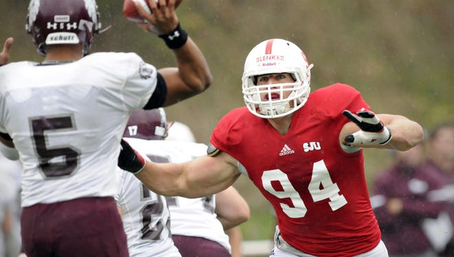 St. John's Nate Blenker tries to block a pass by Augsburg's Ayrton Scott in the second quarter of a 2013 game in Collegeville. Stopping Scott will again be a key when the two teams meet this Saturday at Clemens Stadium.