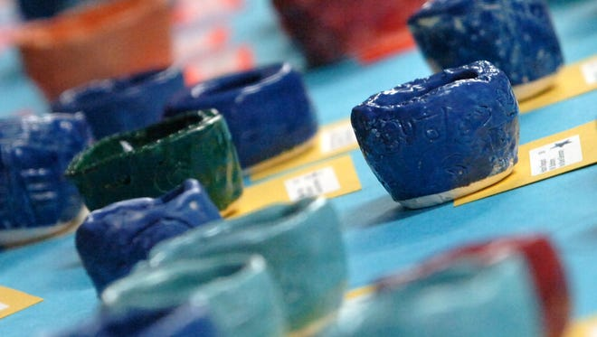A set of bowls made by students at Van Buren Elementary School sits on display during the Empty Bowls fundraiser, Tuesday, November 13, 2007.