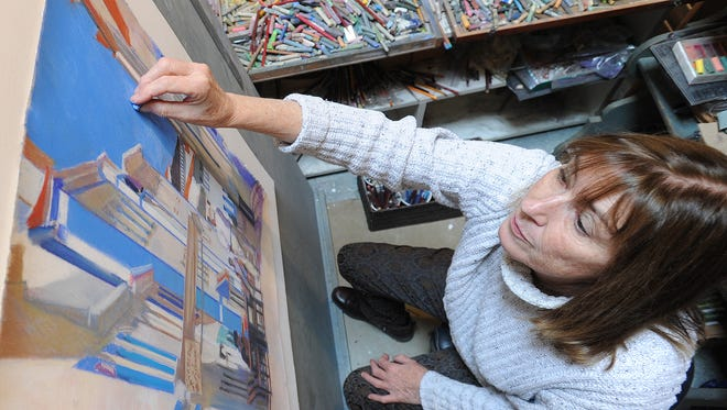 A file photo of artist Laura Hickman at work in her studio. The Southeastern Delaware Artist Studio Tour returns to the Bethany Beach-Ocean View area over the Thanksgiving Weekend as local artist's opened their homes and studios to the public.