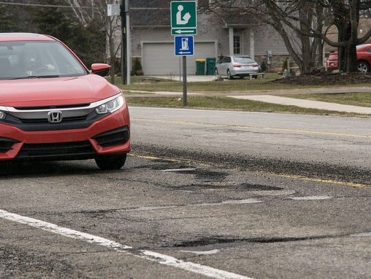 A series of potholes to navigate are on Ten Mile Road,