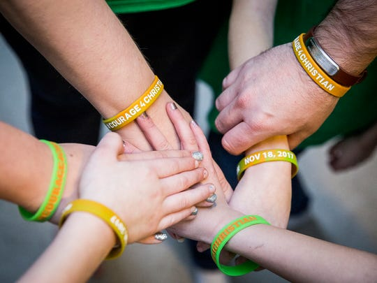 The Daugherty family sport bracelets supporting Christian