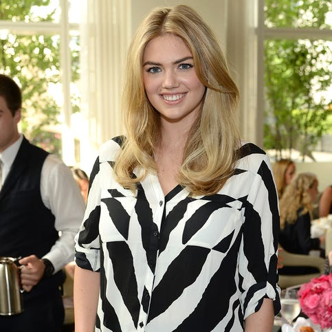 Model Kate Upton poses for the Express & Kate Upton Campaign Launch Event on July 8, 2014 in New York City.