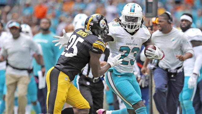 Dolphins running back Jay Ajayi notched a career-best 204 yards Sunday against the Steelers.