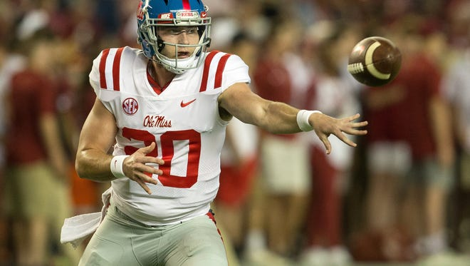 Sep 30, 2017; Tuscaloosa, AL, USA; Mississippi Rebels quarterback Shea Patterson (20) pitches the ball during warm ups prior to a game against the Alabama Crimson Tide at Bryant-Denny Stadium. Mandatory Credit: Marvin Gentry-USA TODAY Sports