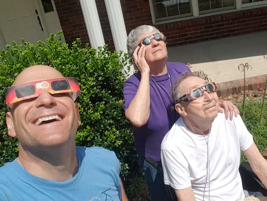 Jerry Jacob watches the Aug. 21 eclipse with his parents.