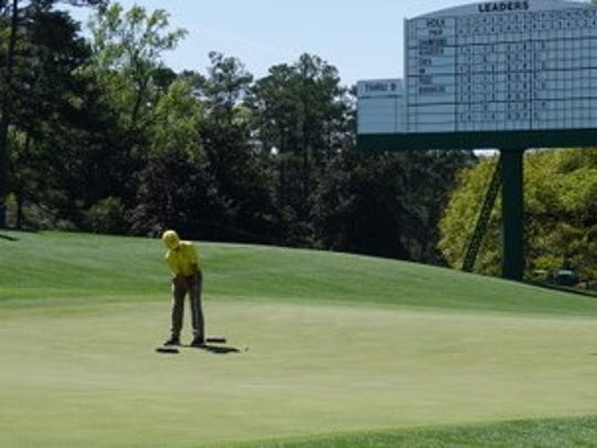 Logan Gonzalez hits a putt during the Drive, Chip and Putt finals at Augusta National.