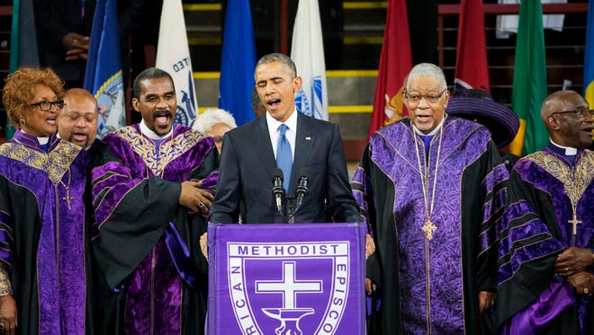 """President Obama sings """"Amazing Grace"""" during services honoring the life of Rev. Clementa Pinckney Friday at the College of Charleston TD Arena in Charleston, S.C.. Pinckney was one of the nine people killed in the shooting at Emanuel AME Church last week in Charleston."""