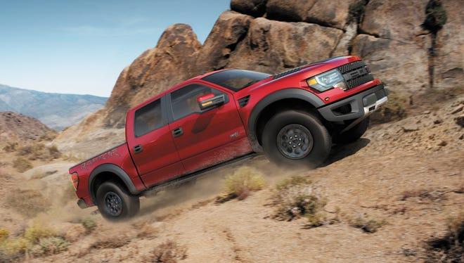 Pricey specialty models, such as this 2014 F-150 SVT Raptor Special Edition, helped automakers push average transaction price of a new vehicle to a record in August.