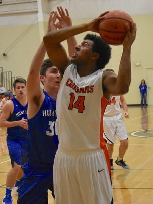 MTCS' Joe Peck eyes the basket during a recent game. Peck finished with a game-high 15 points in the Cougars' 59-56 loss to Community in the Region 5-A tournament to end their season.