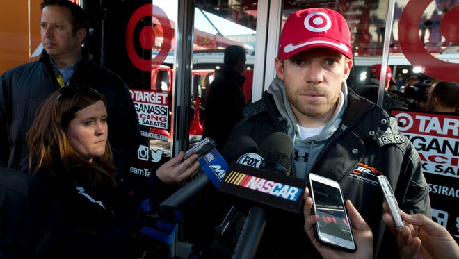 Sprint Cup driver Regan Smith talks to the media outside the hauler of driver Kyle Larson prior to the start of the NASCAR Sprint Cup race at the Martinsville Speedway in Martinsville, Va., on March 29, 2015. Smith is replacing Larson in the No. 42 car after Larson failed to get medical clearance after fainting during an autograph session.