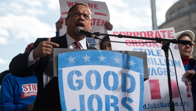 Rep. Keith Ellison of Minnesota speaks at a rally of striking federal contract workers in Washington on Dec. 7, 2016.