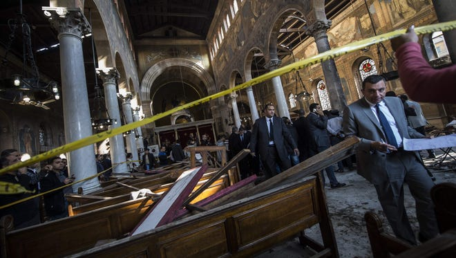 Egyptian security forces inspect the scene of a bomb explosion at a Coptic Church in Cairo on Dec. 11, 2016.