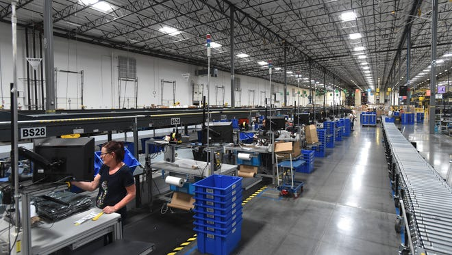 Packages move through the Zulily fulfillment center east of Reno-Sparks.