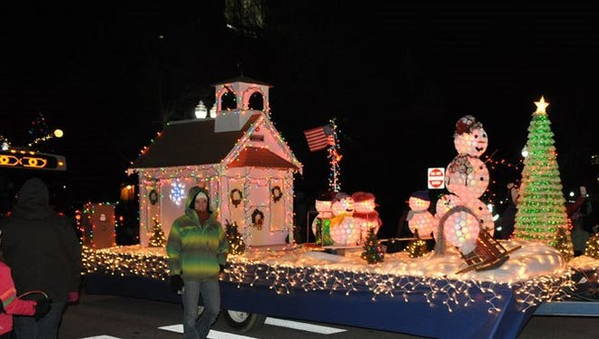 The Dart Container Corporation float in the 2013 lighted Christmas parade in Mason.