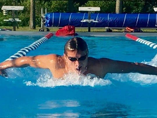 Derek Ledford swims the butterfly.