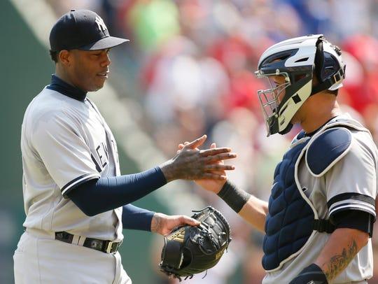 Yankees relief pitcher Aroldis Chapman (54) is congratulated