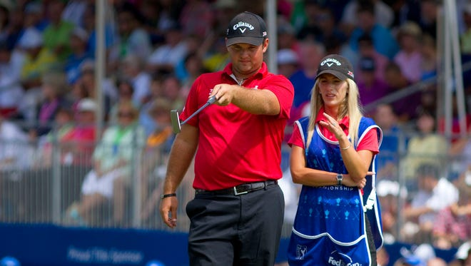 Patrick Reed with his caddie and wife Justine Reed on the 18th green during the final round of the Wyndham Championship.