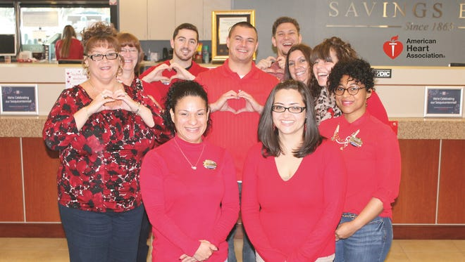 Employees from Century Savings Bank's office in Upper Deerfield support the American Heart Association's Go Red for Women movement.